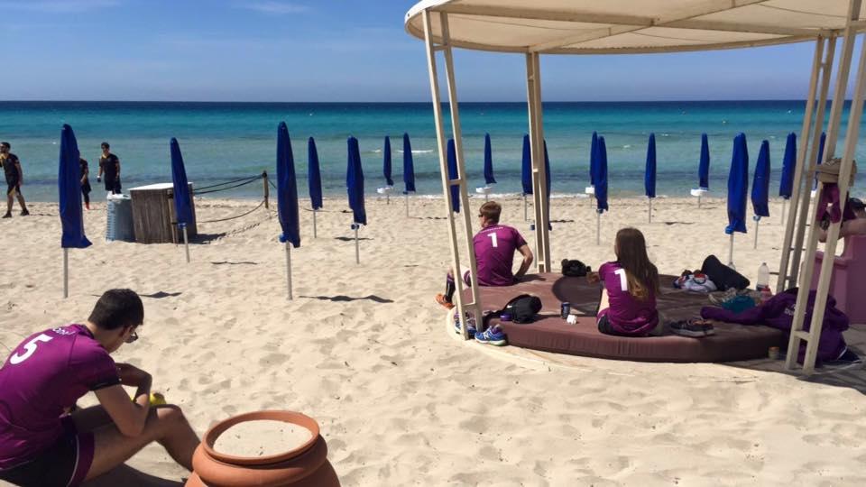 Relaxing on the beach between games. Credit -Caroli Hotels